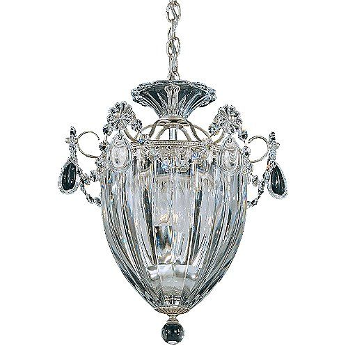 The Schonbek Lighting Bagatelle Pendant reinterprets classic lantern motifs with delicate, sparkling detail. Numerous hand-crafted Heritage Handcut crystals trim the fluted glass shade. The metal frame features complementary curves and is available in a variety of finishes to coordinate seamlessly with any traditional color scheme.