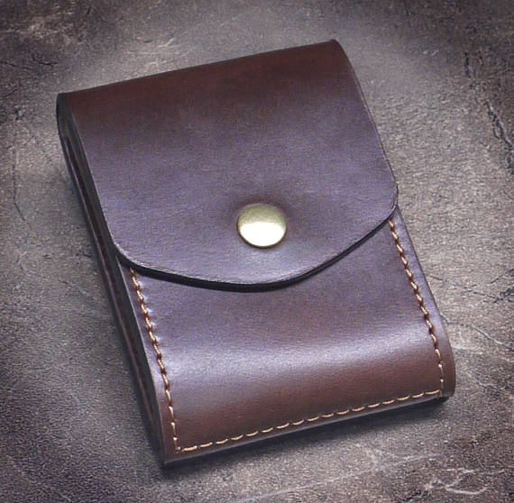 The look, the feel, the smell - intoxicating. The Quintessential Cabrio Money Clip Wallet, now with a convenient ID Window on the back. Youll be proud to own one or give it as a gift! I love slim small wallets that hold a lot and thats why I created my Cabrio Money Clip Wallet.