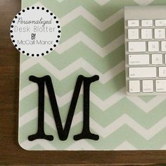 Purchased a simple desk pad;  chose a background fabric; spray the back of the blotter with Craft-Bond from Elmers and place it on top of the fabric.  Stretch and straighten the fabric gently as you go. add a monogram for the final touch (Silhouette or stencil)