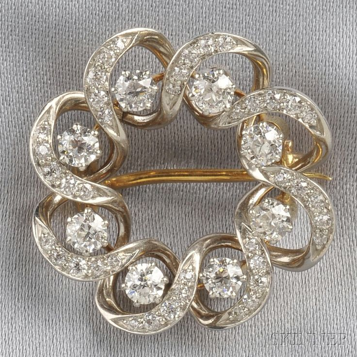 Edwardian Diamond Circle Brooch, set with old European-cut diamonds, approx. total wt. 1.60 cts., platinum-topped 18kt gold mount, lg. 1 in.
