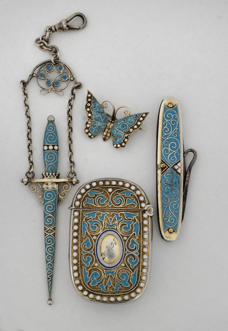 Gustav Gaudernack design for David Andersen.  Silver/gilt silver vesta holder, chatelain toothpick, pocket bootlace puller and butterfly brooch in blue and white enamel, russian style 1895-1898 (Photo A.M. Vindedal)
