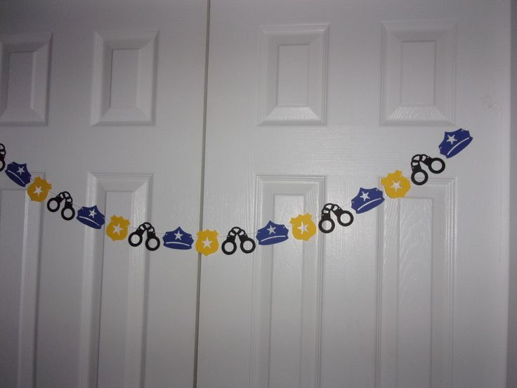 Police Garland - Black, Royal Blue & Yellow Cardstock Paper - Hand Cuffs, Badge, Police Hat Boy Birthday Party Decoration by BBGarlands on Etsy https://www.etsy.com/listing/471060224/police-garland-black-royal-blue-yellow