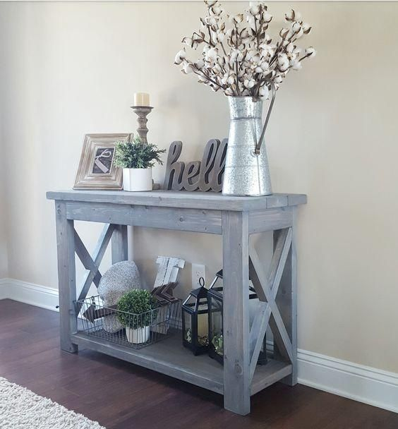 Blue whitewashed console table with X legs looks very traditional