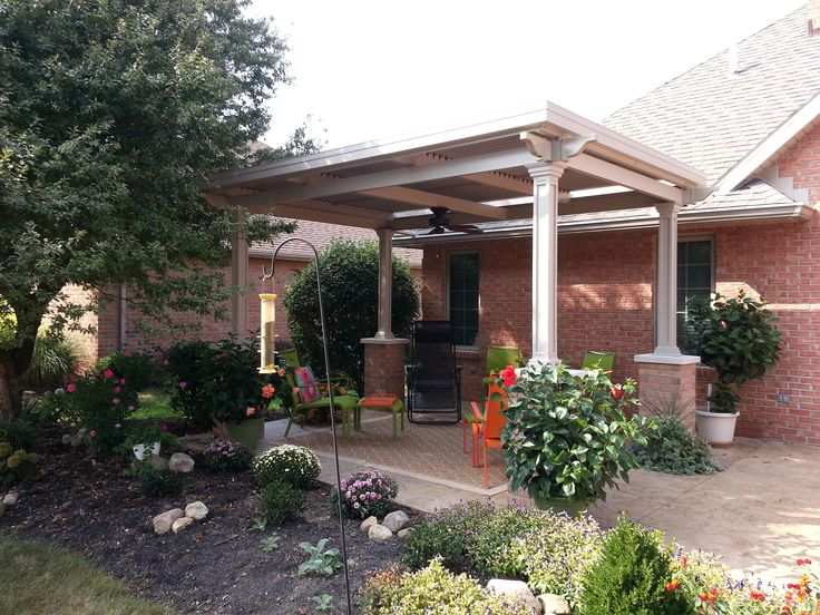 This Louvered Roof Has The New Gutter System That Helps