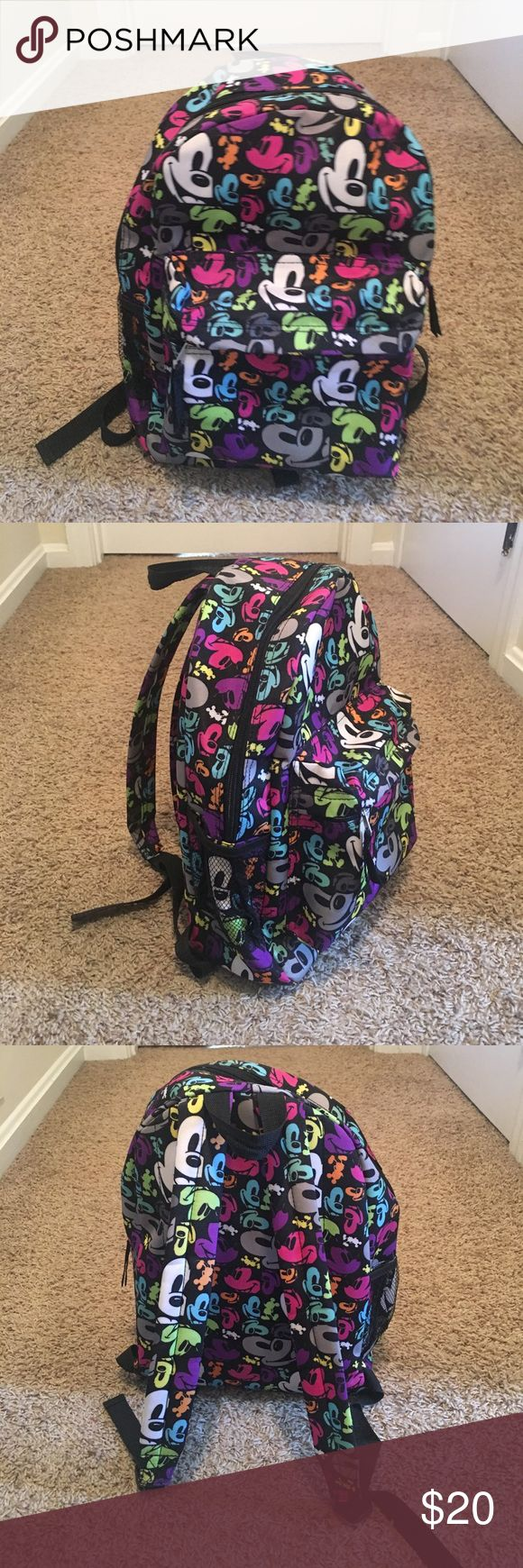 Mickey Mouse Disney Backpack Mickey Mouse pop art print colorful backpack. Front pocket, side mesh pocket, and large interior. Purchased at Disney World on vacation and only carried on that trip. Perfect condition! Such a fun print for youngsters or those young at heart! Disney Bags Backpacks
