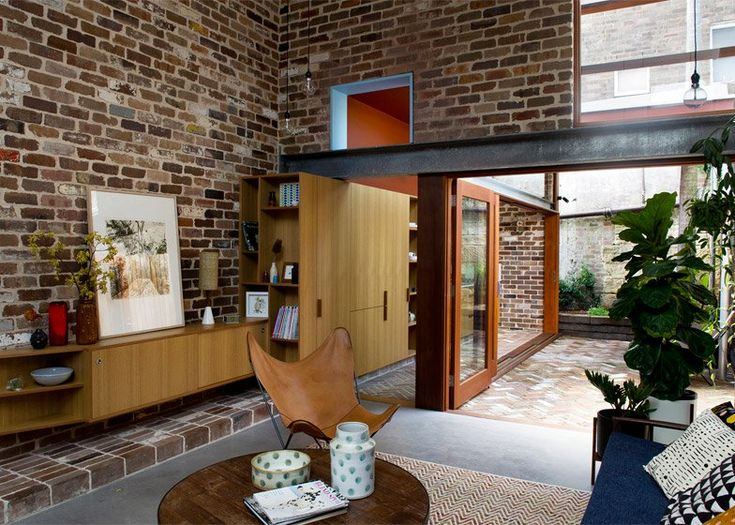 David Boyle used recycled brick to create this double-height living room and mezzanine bedroom, which also provides the psychologist owner with an office