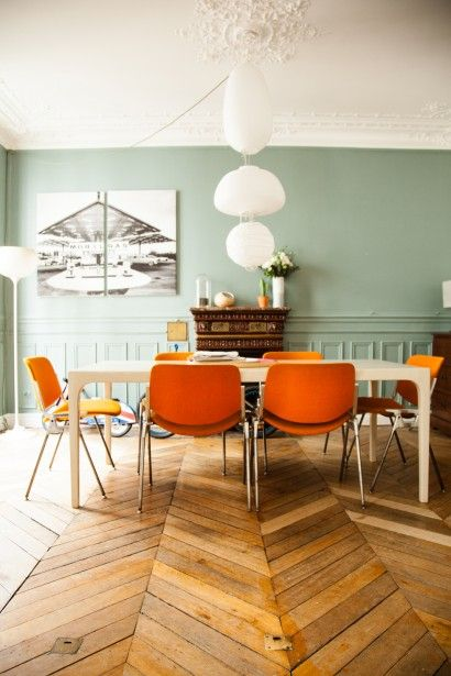 wall color with the orange accent chairs!