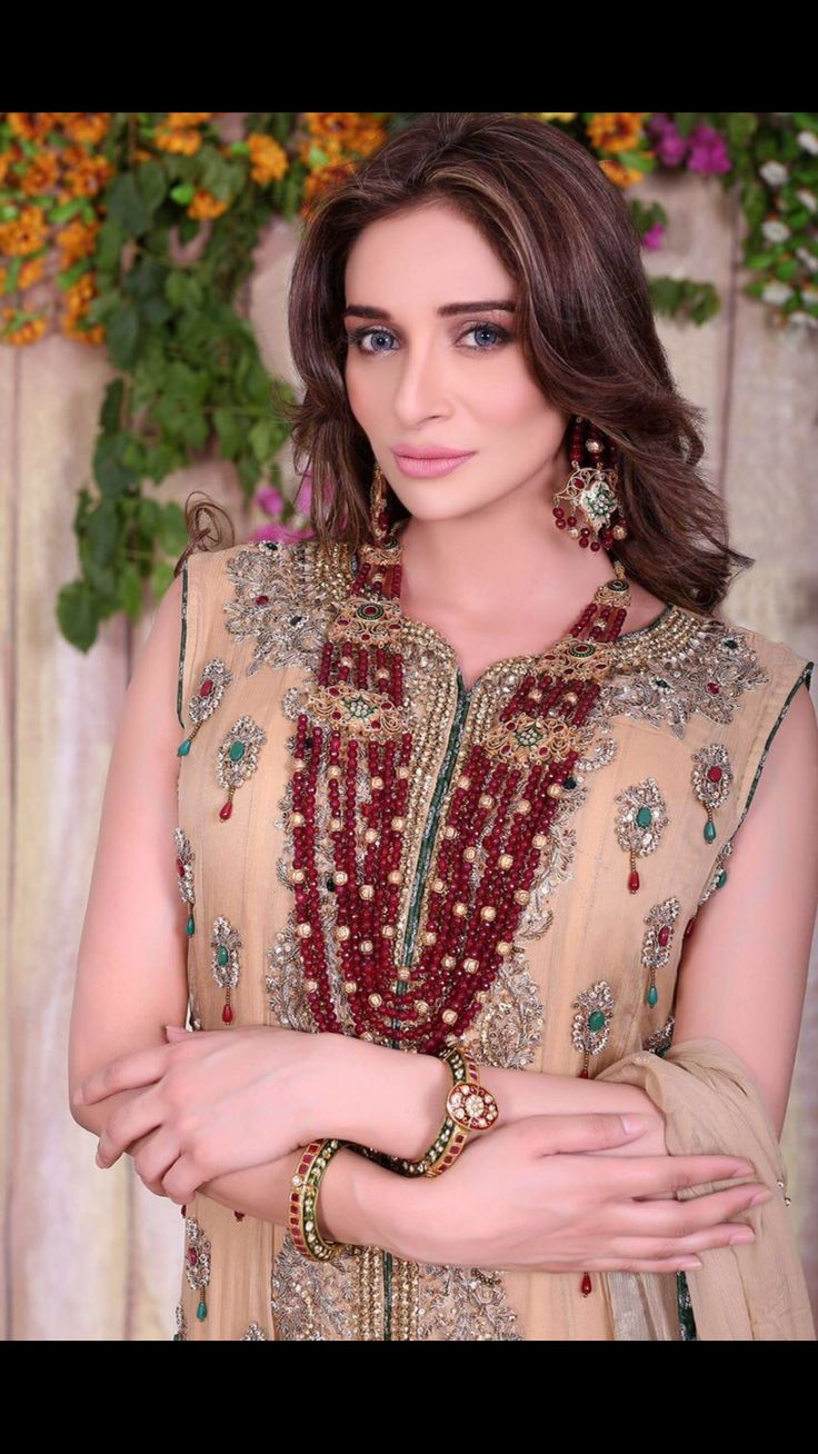 Exquisitely embellished with Ruby, emeralds, Zardozi and cutwork.