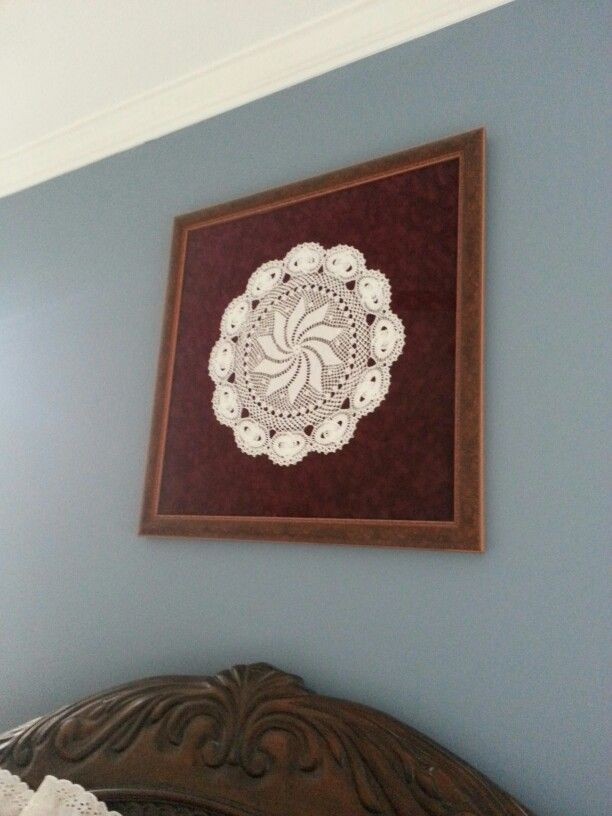 My mother-in-law's hand crocheted doily framed with acid free materials.  Hobby Lobby does great custom framing!