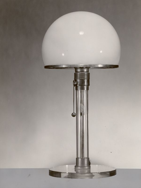 "A table lamp designed by Wilhelm Wagenfeld in Gremany, 1924. The lamp is made from chromed metal and glass. It is often refered to as the ""Bauhaus Lamp"" and embodies a core principle of Bauhaus design - form follows function.  The Museum of Modern Art (2017). ""Wilhelm Wagenfeld, Carl Jakob Jucker Table Lamp 1923-24."" Available: https://www.moma.org/collection/works/4056. Viewed on 13 May 2017."