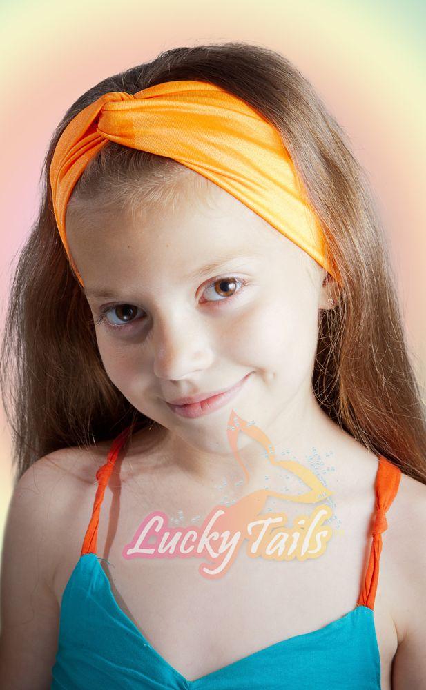 картинка Оранжевая повязка на голову LuckyTails магазин Одежда+ являющийся официальным дистрибьютором в России