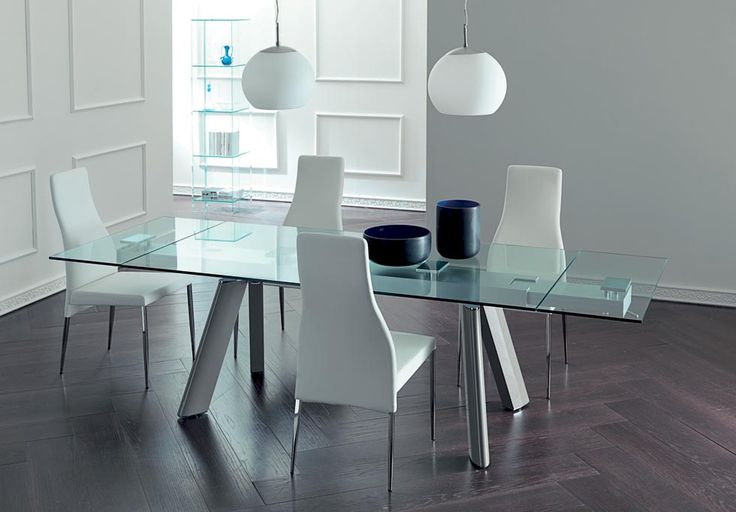 LUXURY . Materials and harmonious shapes are expressed in a charming design.   Extending dining table, metal structure, glass top and visible extensions under the top. http://www.easy-line.it