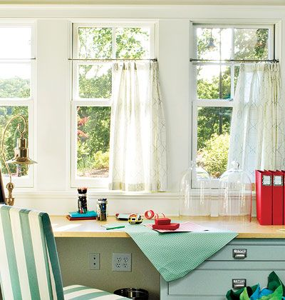 heer Simplicity    This smart home office has sheer café curtains with a smart, graphic pattern. The curtains cover three-fourths of the windows but leave a few inches at the top for light to shine through.