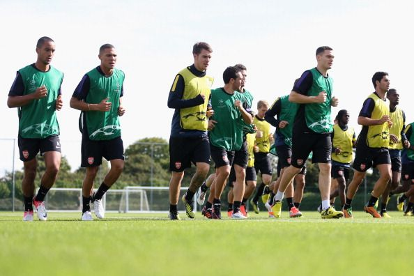 Captain, Thomas Vermaelen of Arsenal leads the team during a training session at London Colney on September 17, 2012 in St Albans, England