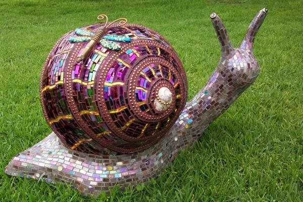 """Glass mosaic snail - Louise The Snail is glass mosaic over concrete and polystyrene. 16""""H x 24""""L x 12""""W. Louise was first created in the styrofoam sculpture workshop then afterwards mosaic was applied. Made by Donnell Pasion of Passiflora Mosaics."""
