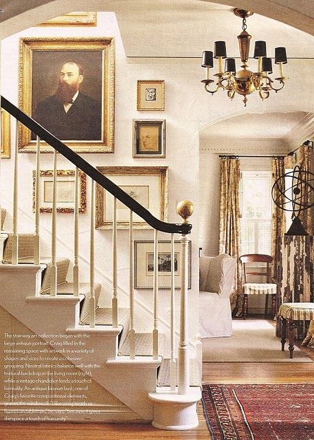 Beautiful details - love the stair rail and the black shades on the chandelier.
