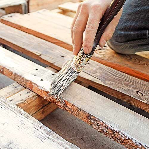 pallet wood headboard step : brush boards with equal parts white latex paint and water. When dry, sand lightly with 60-grit paper. Remove from their frames using a pry bar or claw end hammer.