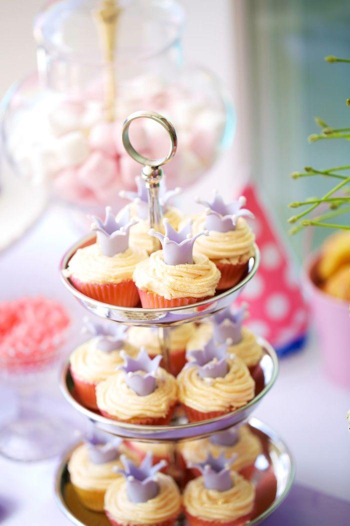 Princess crown cupcakes at a Cinderella themed birthday party via Kara's Party Ideas Kara's Party Ideas KarasPartyIdeas.com #cinderellaparty #princessparty #princesscupcakes #cinderellacupcakes