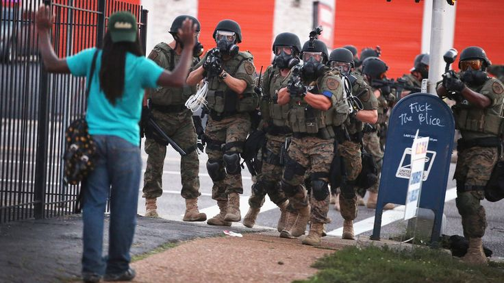 """""""'Hands up, don't shoot!' Michael Brown, an unarmed black teenager, was shot to death by a police officer on Saturday, August 9, in the St. Louis suburb [Ferguson, Missouri]... Ever since, many of Ferguson's black residents have vented their frustration, anger, and sadness at a variety of protests, boldly facing a heavy, intimidating police presence with their hands in the air."""""""