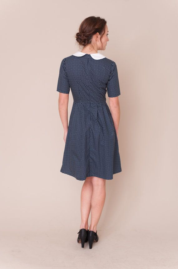 Handmade vintage inspired dress with short sleeves and pleated skirt. Navy cotton fabric with small white spots and white peter pan collar with piped edging. Concealed zip fastening at the back of the dress. All garments are handmade in Manchester and made to order, please allow 5-7 working days to make each garment. Available in sizes: UK 8 - waist fits 26.5 / 67 cm chest fits 34 / 86 cm UK 10 - waist 27.5 / 70 cm chest 35 / 89 cm UK 12 - waist fits 29 / 73.5 cm...