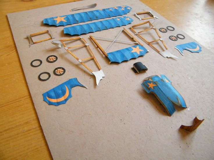 "Paper model  ""Mia"" in process of construction. This model  is loosely based on a real historical aircraft Caudron G.3. It is designed for beginners and children."