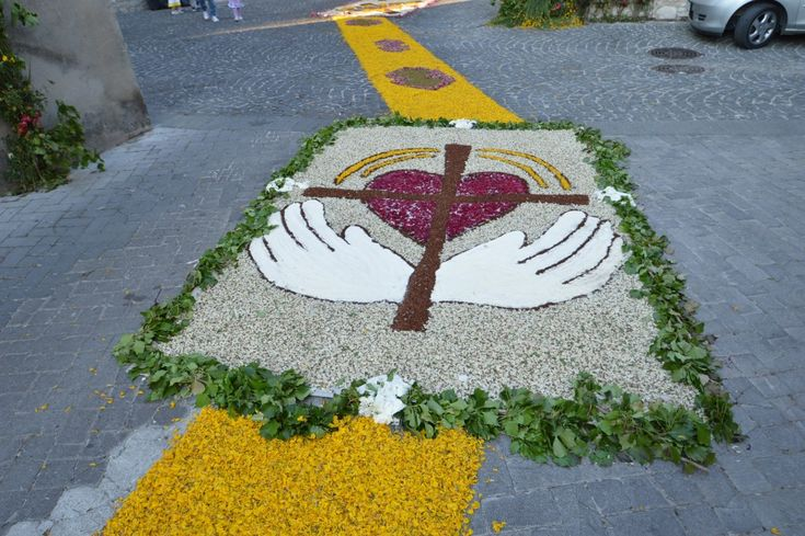 Infiorata festival is tradition synonym of not only religiousnees, but solidarity among different cultures and people. The flowers are arranged on the road.