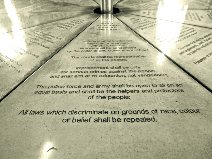 """""""All laws which discriminate on grounds of race, colour, or belief shall be repealed."""" Monument in Johannesburg, South Africa depicting the pillars of the South African post-apartheid constitution."""
