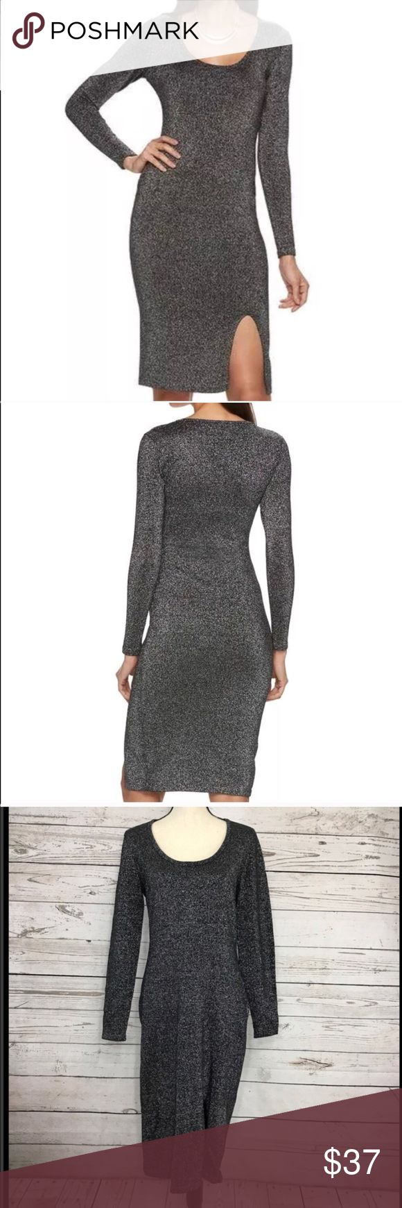 "JLO Jennifer Lopez Sheath Long Sleeve Dress New Gorgeous black, silver metallic long sleeve, sheath dress with a 9"" front slit. Perfect for holiday parties! New with tags. Bust: 37 1/2"". Length in the back from the shoulder: 43 1/2"". Measurements are approximate. Smoke free home. Thanks for shopping my closet 🌺! Jennifer Lopez Dresses Long Sleeve"