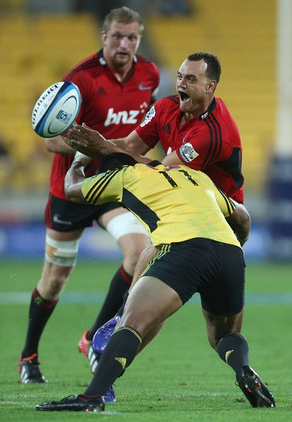 Israel Dagg and Julian Savea Photos - Julian Savea of the Hurricanes tackles…