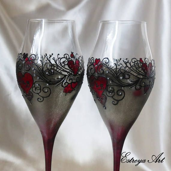"""Set of two hand painted toasting flutes """"Gothic style glasses"""". These rich glasses with black lace and hearts are in black, gray and red/or purple with a hint of glitter. They are unique and perfect present for weddings on the beach, anniversaries, birthdays, special occasions or just for romantic /special dinners. Please note that slight difference in the designs of the two glasses/flutes is possible due to the fact that they are hand painted and the items you will receive a..."""