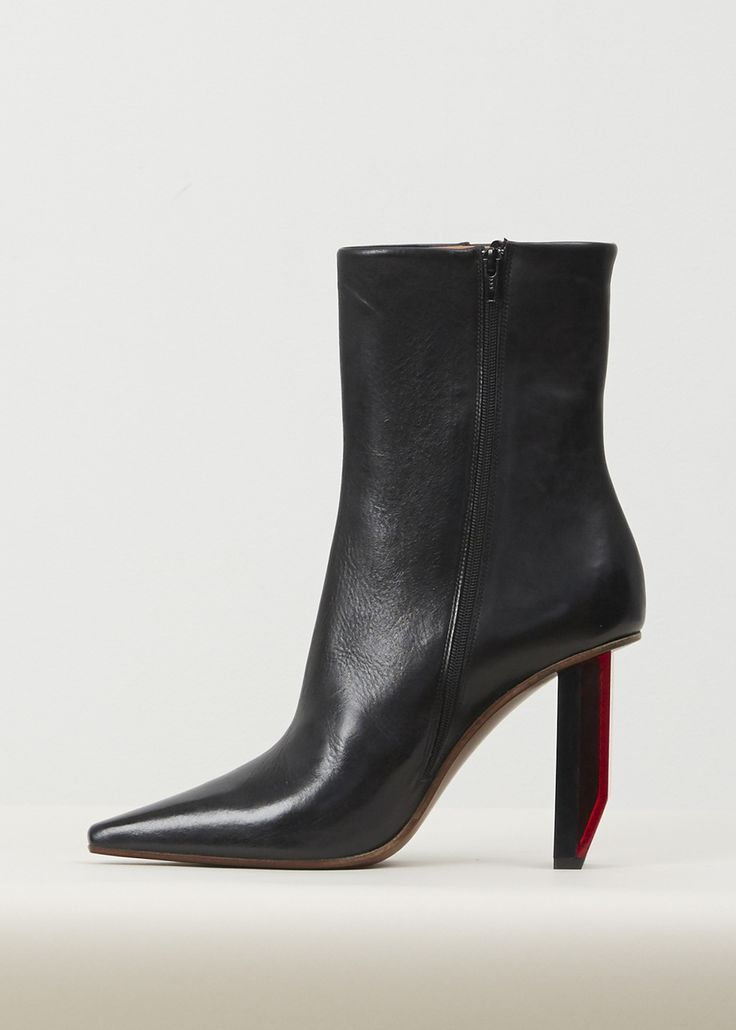 Pointed toe ankle boot with reflector heel. Zipper closure at inner ankle,  leather insole.