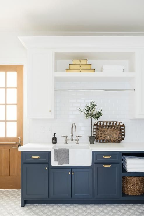 Blue And White Laundry Room Featuring A Farmhouse Sink White