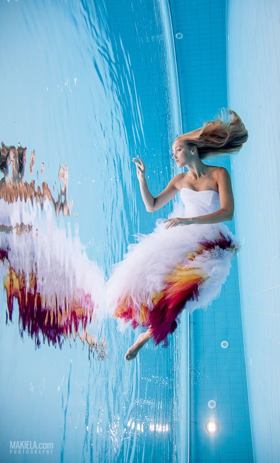 This is incredible... Looks like she is sinking, yet her hair is flowing straight down while the dress is going up.. Wow.