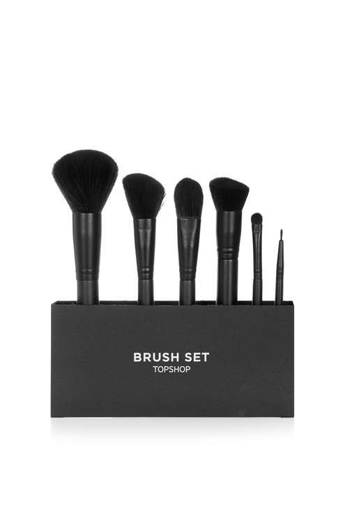 Brush set, containing six synthetic makeup brushes to help apply, buff and blend makeup. Set contains our bestselling stippling brush, large powder brush, sculpting brush, foundation brush, blending brush and liner brush, all in a new sleek matte black design. Help your brushes stay clean and hygienic by washing in warm soapy water, for a deep clean use our brush cleansing tool. Air dry so the shape stays perfect. #Topshop