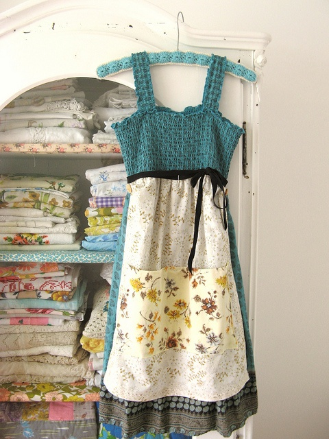 a frock to an apron. and look at the stash of vintage fabrics!!