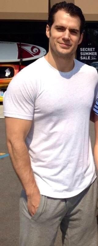 Nobody wears a plain white T like Henry Cavill. He's about to bust out of that thing.