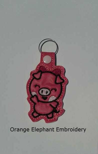 ITH Waving Pig Snap Tab Key Fob Machine Embroidery Design Included: one machine embroidery digital design file For the 5x7 and 4x4 inch hoop Formats include: EXP, HUS, JEF, PES, VIP, XXX Terms of Use are listed in the Terms Section Image shows what it may look like stitched out.