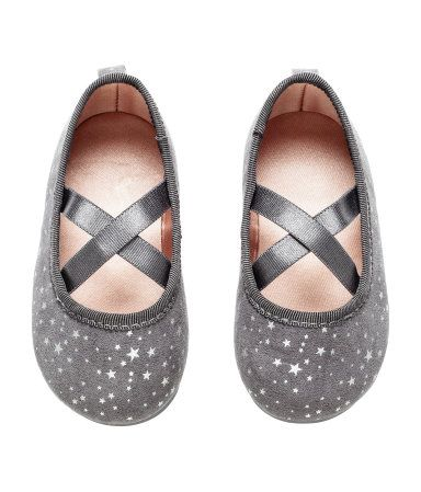 Dark gray/stars. Ballet flats with an elastic strap over foot. Satin lining, satin insoles, and rubber soles (sizes 1 - 2 with soft soles).