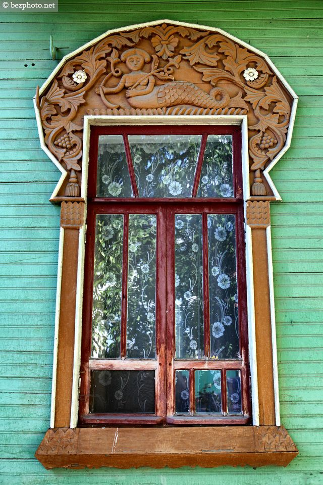 decorative carved wood window frame with mermaids, gorokhovets, russia | architectural details