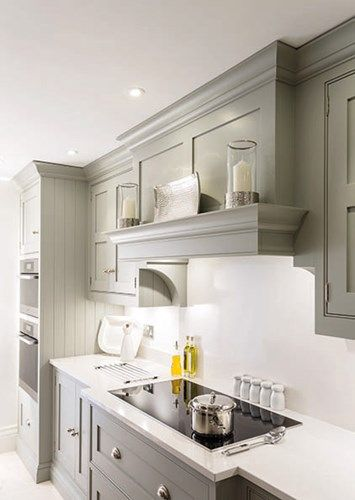 Nice soft gray, simple hood solution for a low ceiling.                                                                                                                                                                                 More
