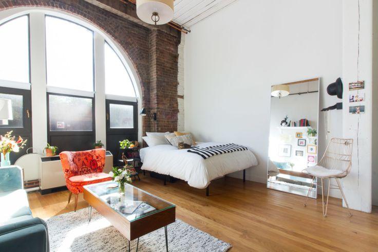 New York studio apartment with eposed brick