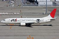 Japan Transocean Air-JTA (JP) Boeing 737-4Q3 JA8526 aircraft, with the stickers ''Coober & Unicef '' on the airframe, skating at Japan Nagoya Chubu Centrair Airport. 23/09/2011. (Coober=character of Ryujin Mabuyer).