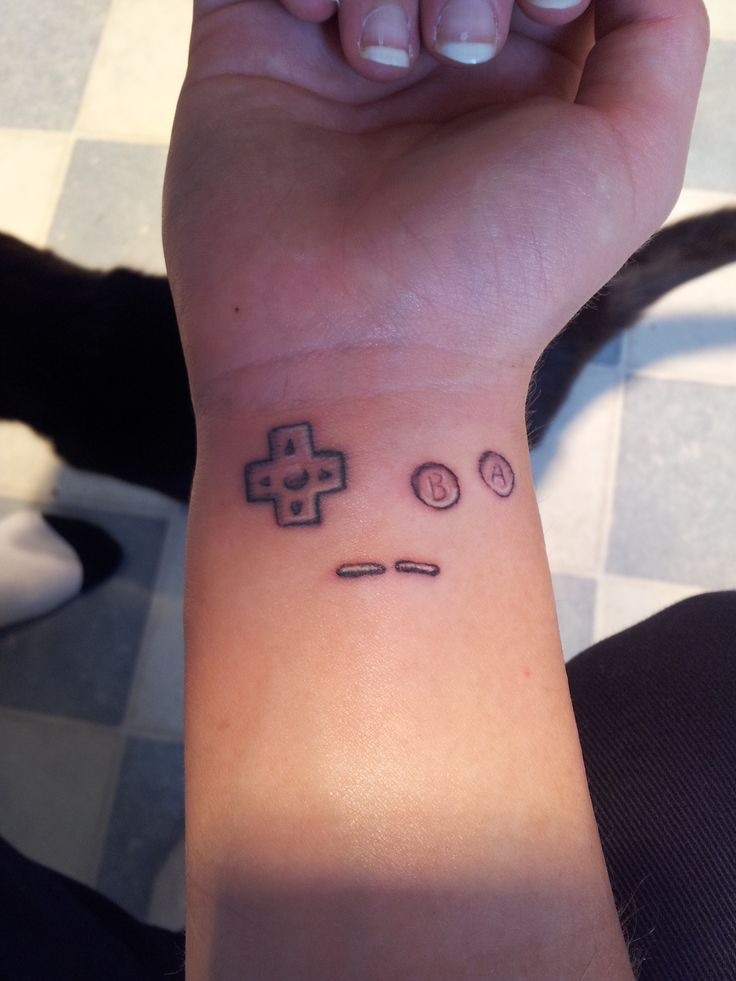 This is my Gameboy buttons tattoo. Based on the Gameboy Pocket, my first Gameboy. It didn't turn out how I wanted it, and I kinda hate it. But I thought I'd share anyway.Can't remember where or who did it. But it was some place in Hobart, Tasmania.