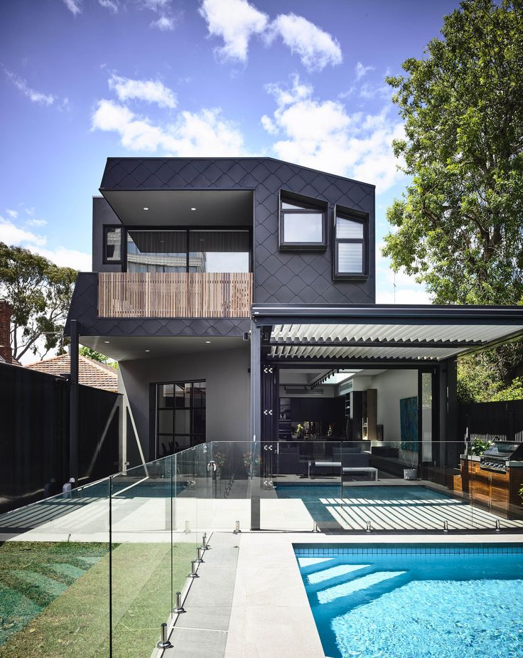 Rear facade of zinc shingles metal cladding overlooking the paved ppol