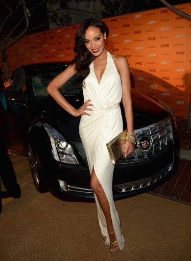 Selita Ebanks in white v-neck dress with leg split