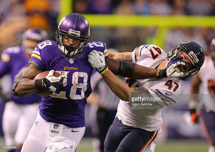 Adrian Peterson #28 of the Minnesota Vikings carries the ball for ten thousand career rushing yards against Chris Conte #47 of the Chicago Bears on December 1, 2013 at Mall of America Field at the Hubert Humphrey Metrodome in Minneapolis, Minnesota.