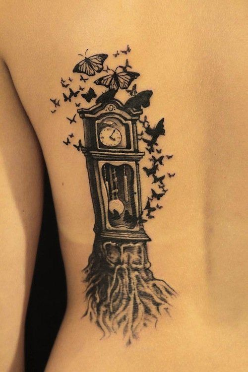 This tree morphed into a clock and became a home for butterflies. Tattoo, InkedMagazine