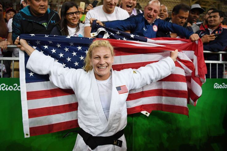 Kayla Harrison (USA, white) reacts with fans after defeating Audrey Tcheumeo (FRA) in the women's 78kg gold medal judo contest at Carioca Arena 2 during the Rio 2016 Summer Olympic Games.     -  Best images from Aug. 11 at the Rio Olympics