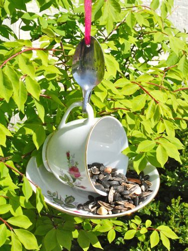 Tea Cup Bird Feeder - a cup and saucer, glued together along with a spoon that is used as a hanger. Clever!