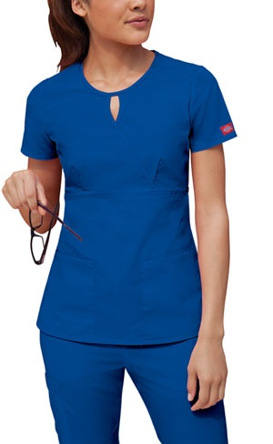 "Dickies Keyhole Scrub Top in Royal  Original Junior Fit keyhole mock wrap top features an empire waist and bust darts. Patch pockets and side vents. Center back length: 25 1/2"". Fabric: 65 Poly / 35 Cotton Poplin $11.99"